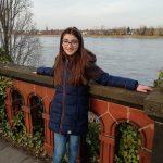 Teen Zena Marouf standing in front of a river